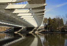 Under Vimy Memorial Bridge with Reflection on Rideau River in Ottawa Ontario Canada Royalty Free Stock Image