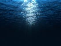 Under water. Dark blue under water image with sun rays Stock Photo