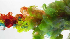 Under water liquid colors mixing. Colorful liquids in dynamic flow mixing in interesting shapes. Color jet of ink on white background. Liquid organic sculptures stock video footage