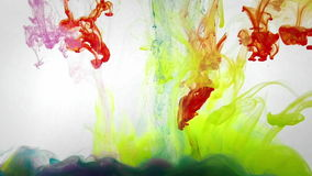 Under water liquid colors mixing. Colorful liquids in dynamic flow mixing in interesting shapes. Color jet of ink on white background. Liquid organic sculptures stock video