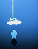 Under the Weather. Little wooden person icon standing underneath a paper cloud on a blue background. Could refer to being sick or under the weather, cloud royalty free stock images
