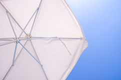 Under a white beach umbrella Royalty Free Stock Photography