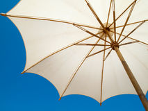 Under a white umbrella Royalty Free Stock Photo