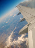 Under the wing. Beautiful mountain ridge under the wing of airplane stock photos