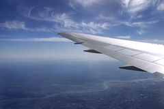 Under the wing. View from plane . blue sky, earth, river stock photography
