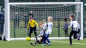 Under 9 years old football cup match. Under 9`s football cup match. Vauxhall Mokkas versus West Kirby Panthers. 10th March 2018 at Ellesmere Port Cheshire royalty free stock image