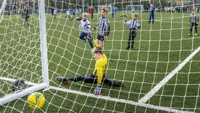 Under 9 years old football cup match. Under 9`s football cup match. Vauxhall Mokkas versus West Kirby Panthers. 10th March 2018 at Ellesmere Port Cheshire stock image