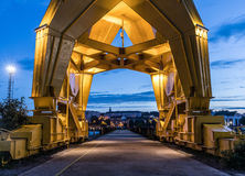 Under the yellow crane by nigh Stock Photos