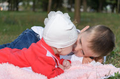 Underage boy with his little sister Stock Photos