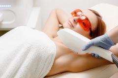 Underarm laser hair removal treatment woman. Process body care. Health and beauty royalty free stock images