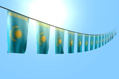 Underbart hänger många Kasakhstan flaggor eller baner diagonalt på rep på bakgrund för blå himmel med bokeh - någon ferieflagga 3 royaltyfri illustrationer