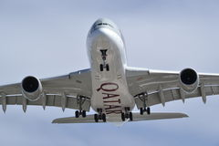 Underbelly landing airplane Airbus Qatar Airways Stock Photo