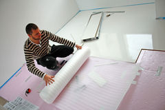 Underbody isolate. Workers laid laminate in home renovation Stock Photo