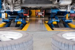 Undercarriage of a car in garage. vehicle maintenance in auto re. Pair service shop. automobile annual checkup.  fixing, checking concept Royalty Free Stock Photo