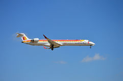 Undercarriage Down. An Air Iberia passenger plane coming into land a Alicante Airport Stock Photo