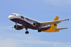Pasenger Aircraft Undercarriage Down On Fnal Approach - Monarch Airlines. A holiday jet on its final approach to Alicante airport Royalty Free Stock Photo