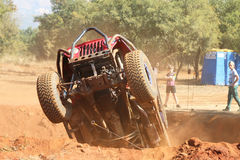 Undercarriage of red car ramping out of steep dugout. Rustenburg, South Africa – JUNE 17, 2017: National Extreme Modified 4x4 Vehicle Championship. Spectacular Royalty Free Stock Photo
