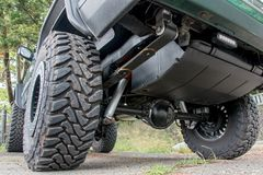 The undercarriage of terrain car. Chassis off road vehicle in the parking lot. The undercarriage of terrain car on way in nature Stock Photos