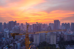Underconstructing building in Guangzh. Flaming cloud at night and underconstructing building in Guangzhou urban area Royalty Free Stock Images