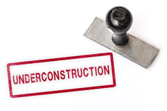 Underconstruction word stamp. Royalty Free Stock Photo