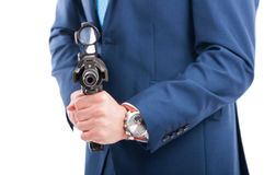 Undercover agent aiming the  gun at the camera Stock Images