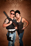 Undercover Cops or Criminals. Glamorous Undercover Cops or Criminals with Shotgun and other Firearms Stock Images