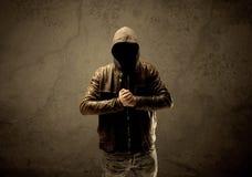 Undercover hooded stranger in the dark Stock Image