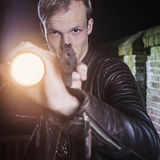 Undercover law enforcement special agent aiming gun and torch Stock Images