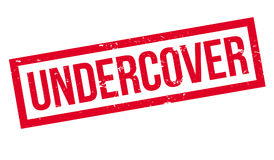 Undercover rubber stamp Royalty Free Stock Photos