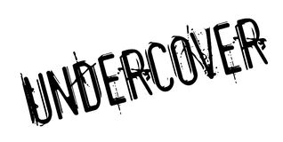 Undercover rubber stamp Stock Images