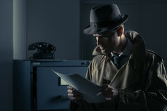 Free Undercover Spy Stealing Files Stock Image - 98475851