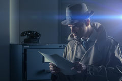 Undercover spy stealing files Stock Images