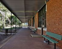 Undercover Walkway. A long undercover walkway stretches along the side of old brick classrooms at a primary school Stock Photography