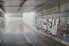 Undercrossing With Graffiti Stock Images