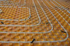 Underfloor heating. Orange posed Underfloor heating tube in a construction site Royalty Free Stock Photography