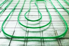 Underfloor heating green pipe installation Royalty Free Stock Photo