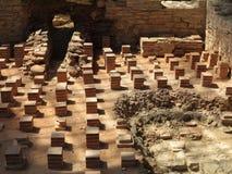 Underfloor heating system Roman bath in sunlight Stock Image