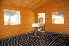Underfloor Heating System in Wooden House Stock Photography