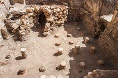 Underfloor på offentliga bad på Aptera, Kreta Arkivbild