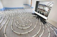 Underfloor uppvärmning i konstruktion fotografering för bildbyråer