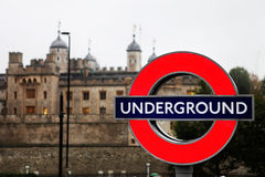 Underground. London underground sign with tower of london in the background Stock Image