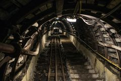 Underground black coal mine with rail tracks. Black coal mine, Silesia, Poland royalty free stock photography