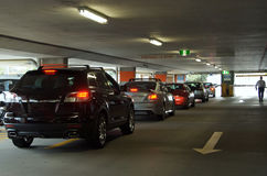 Underground car park. Cars lined up to exit an underground car park Stock Photo