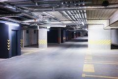 Underground car parking garage in European modern apartment building. Underground car parking garage in a European modern apartment building royalty free stock photos