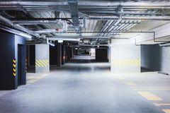 Underground car parking garage at European modern apartment house. Underground car parking garage at a European modern apartment house stock images