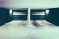Underground car parking garage in modern residential building. Underground car parking garage in a modern residential building royalty free stock photography