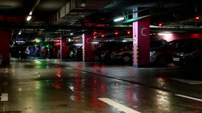 Underground car parking in a large shopping center. People stock footage