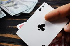 Underground casino, play cards for money caught ace Royalty Free Stock Image