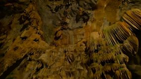 Underground cave world is amazing with its magnificance. Huge stalactites hang from the ceiling of the cave forming bizarre patterns stock footage