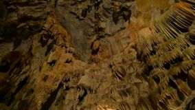 Underground cave world is amazing with its magnificance. Huge stalactites hang from the ceiling of the cave forming bizarre patterns stock video footage